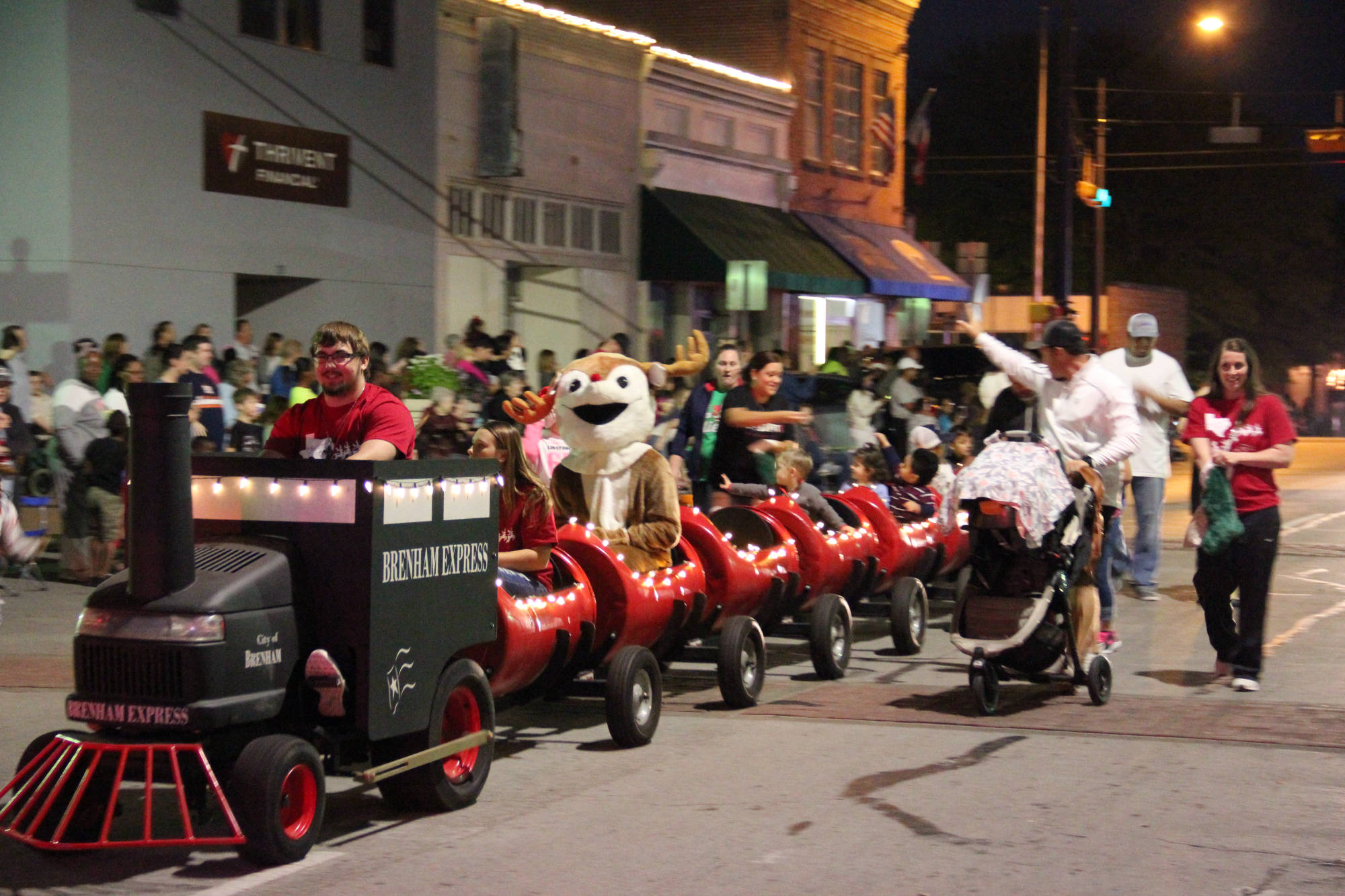 barrel train with city staff passing out candy - Frosty and Rudolph and kids sitting in barrels